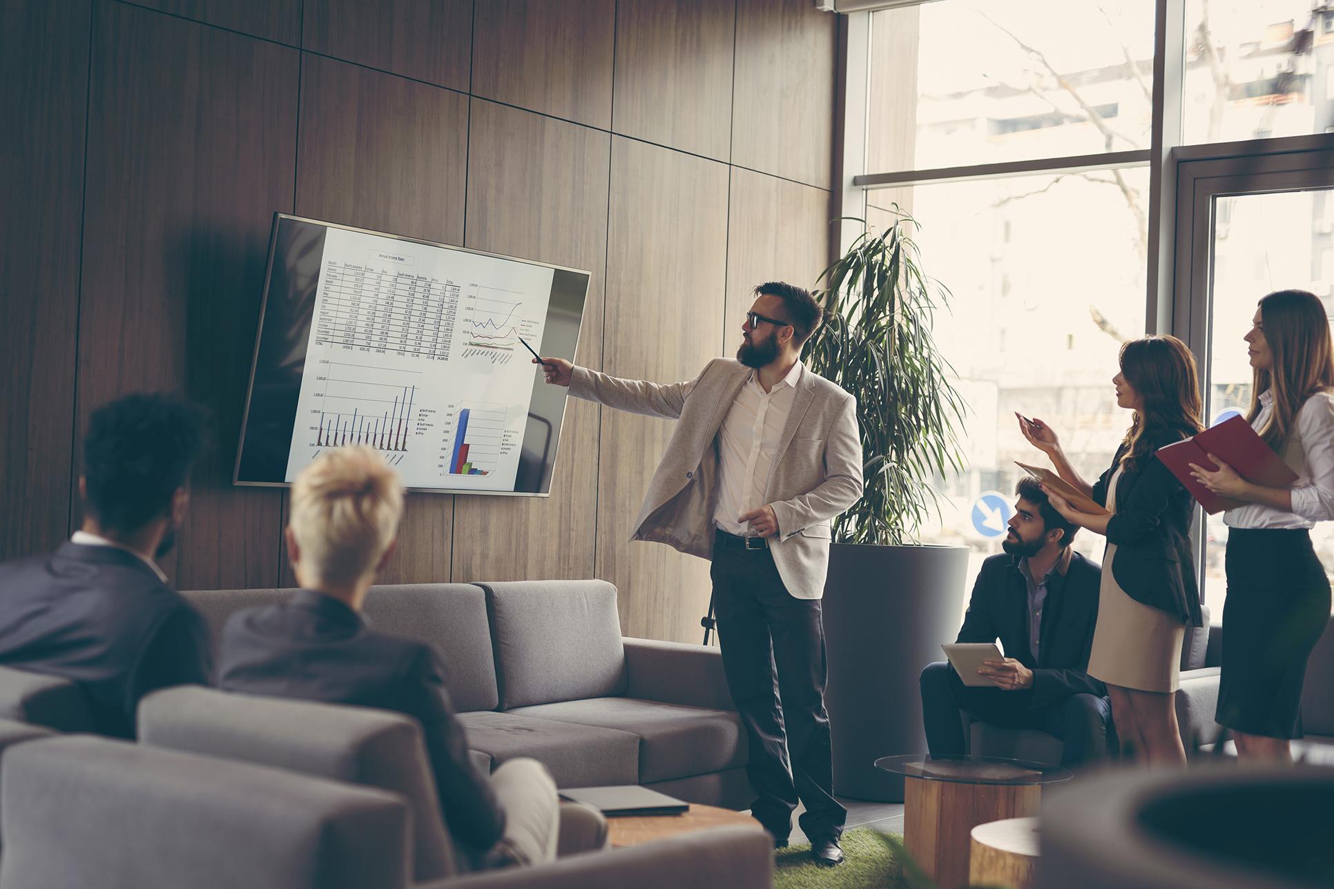 Business meeting discussing data analytics