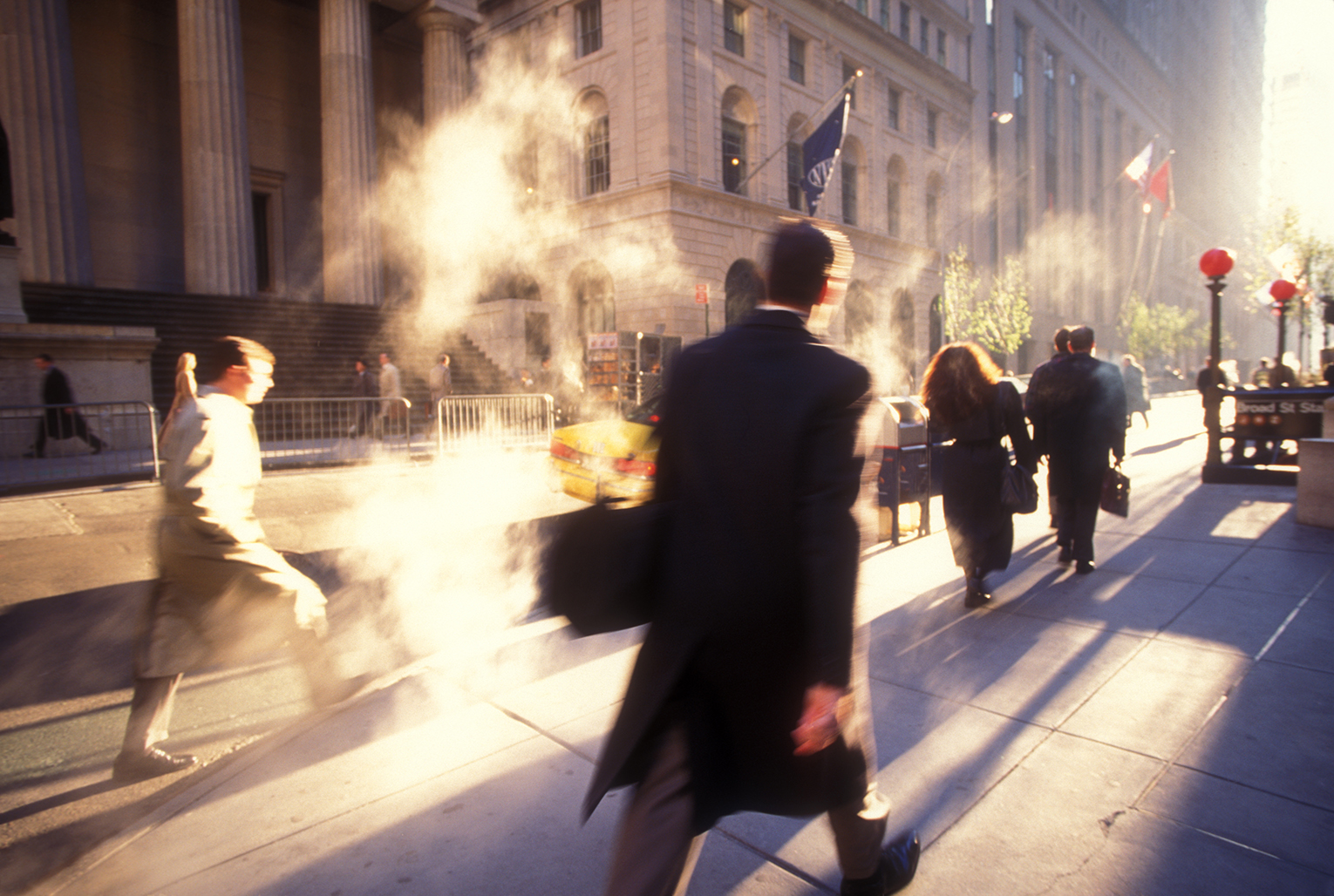 Early morning, NYC, workers are heading to their jobs.